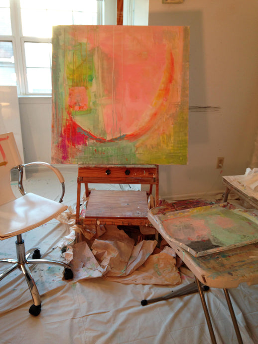 green and pink large square original painting on easel in studio
