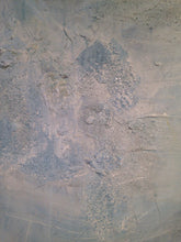 texture on close up of original painting in blue