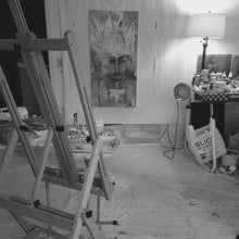 black and white photo of art studio with easel and painting on wall by cheryl wasilow
