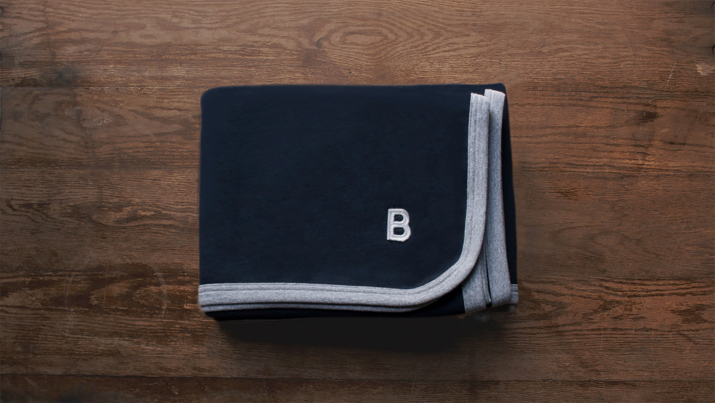 Navy Beresford Blanket with a B felt patch