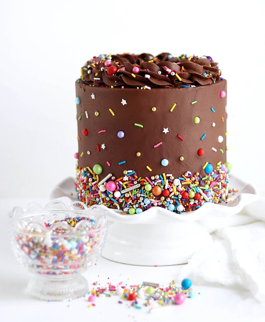Chocolate cake with Rainbow sprinkles by SprinklePop