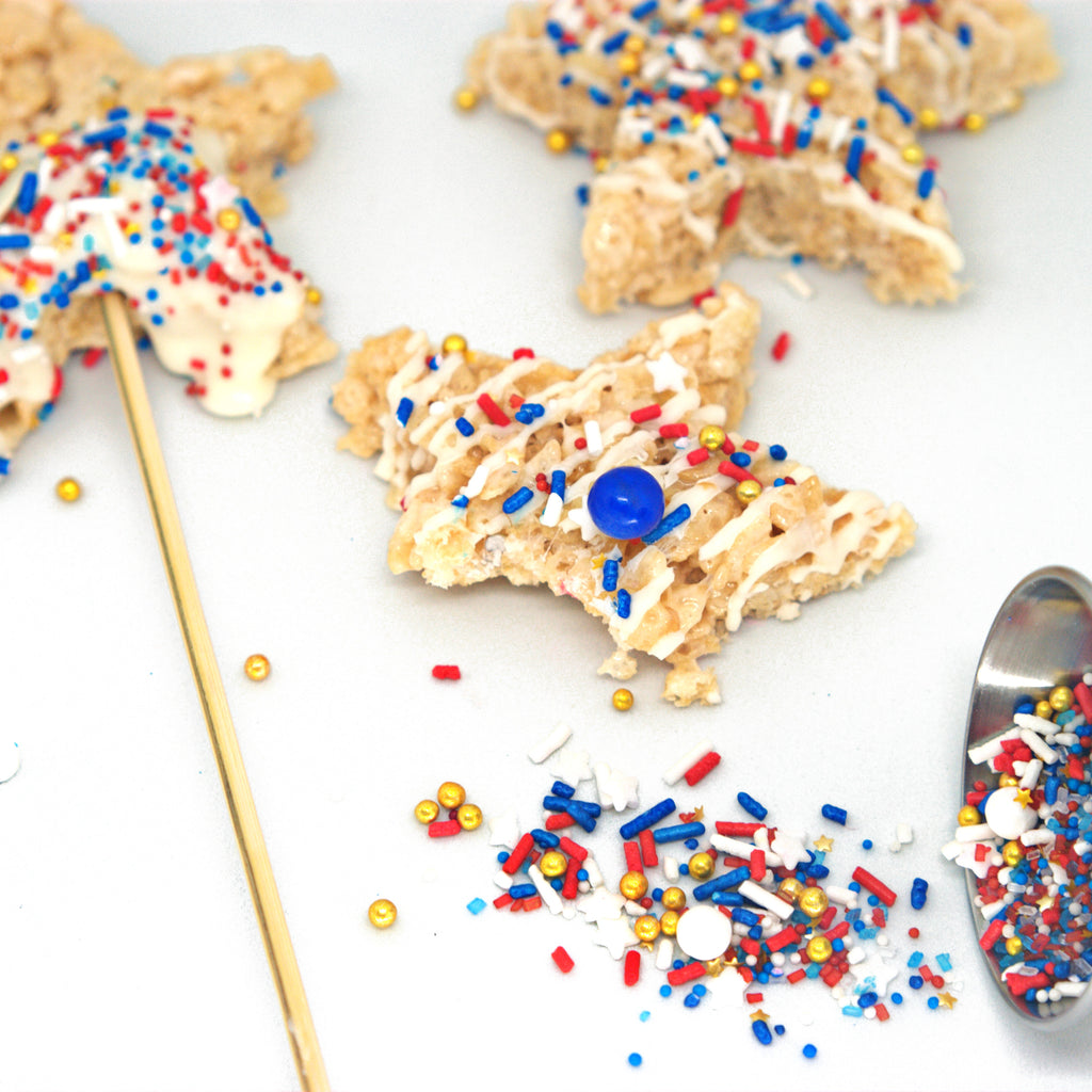 Patriotic rice crispie treat cutouts with red white and blue sprinkles