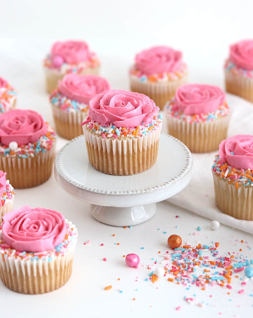 Buttercream rose cupcakes with sprinkles