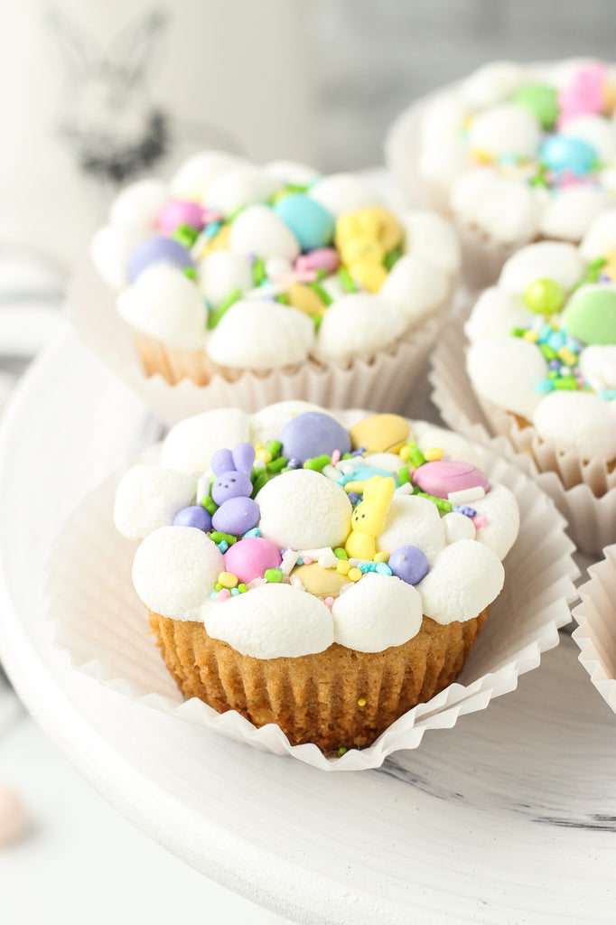 Easter cookie cups in muffin tins with marshmallows, sprinkles and M&M's