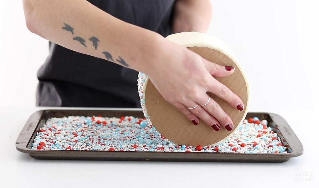 rolling a cake in sprinkles by SprinklePop