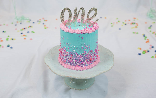 So She Got A Vanilla Cake With Swiss Meringue Buttercream Adorned Our Pink Ombre Sprinkle Mix Enjoy