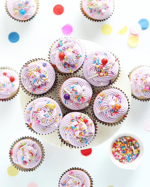 Cupcakes with Lavender Frosting and Rainbow Road Sprinkle Mix
