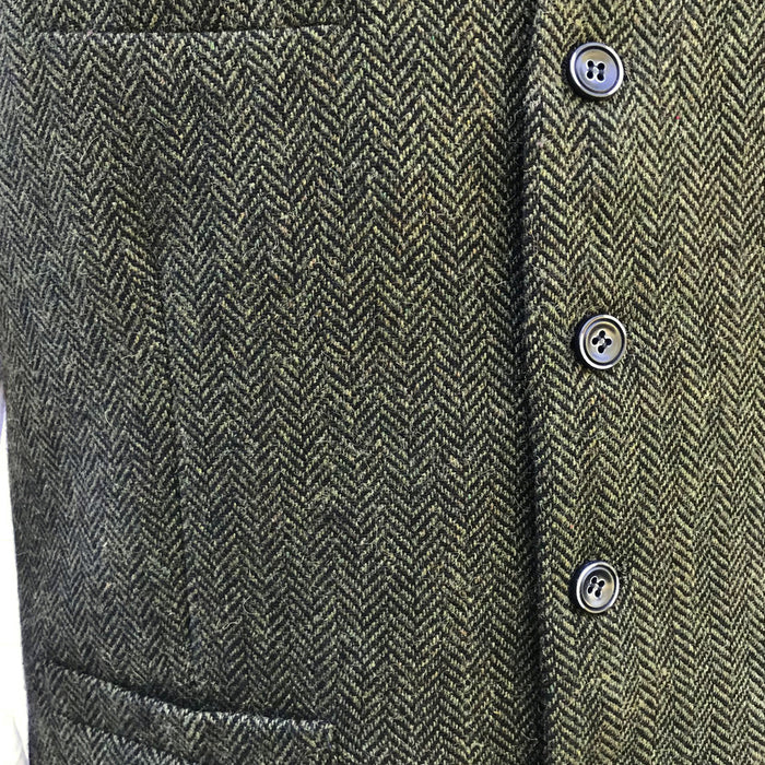 buttons and detail of olive green blended wool vest by celtic ranch