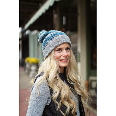 model of grey and blue basket weave bobble hat by aine knitwear