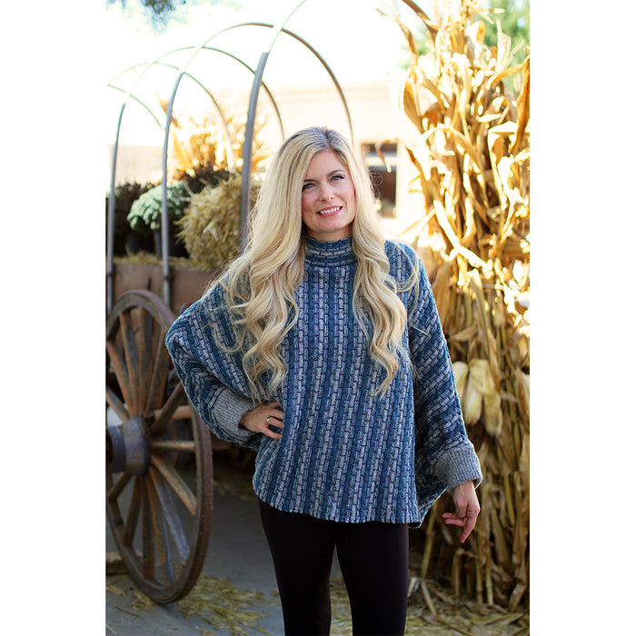 model of grey and blue basket weave sweater poncho by aine knitwear