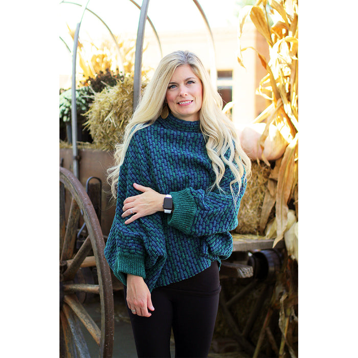 model of jade basket weave sweater poncho by aine knitwear