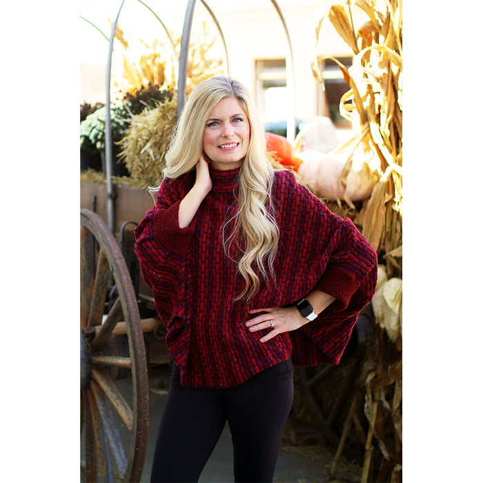 model of redberry basket weave sweater poncho by aine knitwear