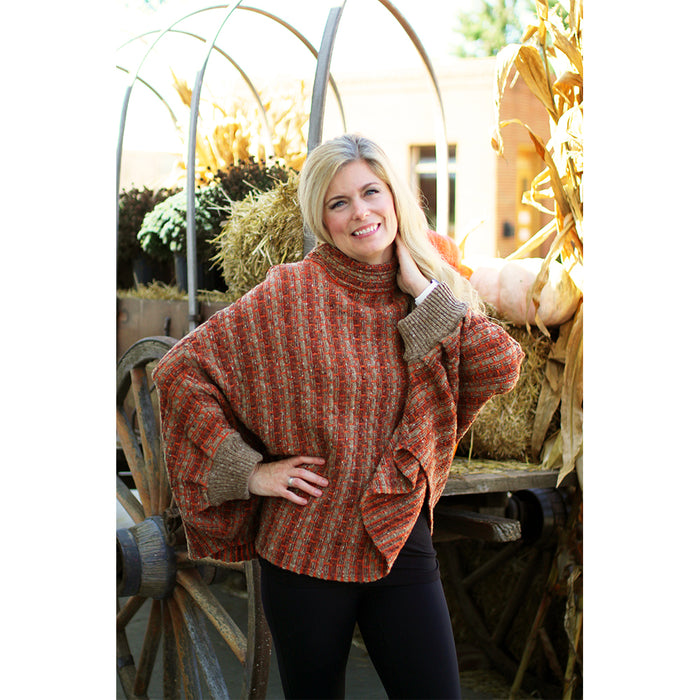 model of rust basket weave sweater poncho by aine knitwear