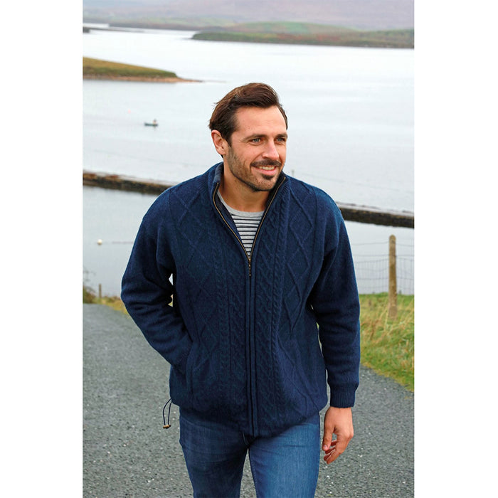 male model of navy full zip merino wool sweater jacket by aran woollen mills