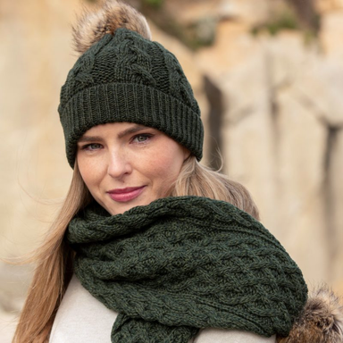 model of army green wool cable knit hat by west end knitwear