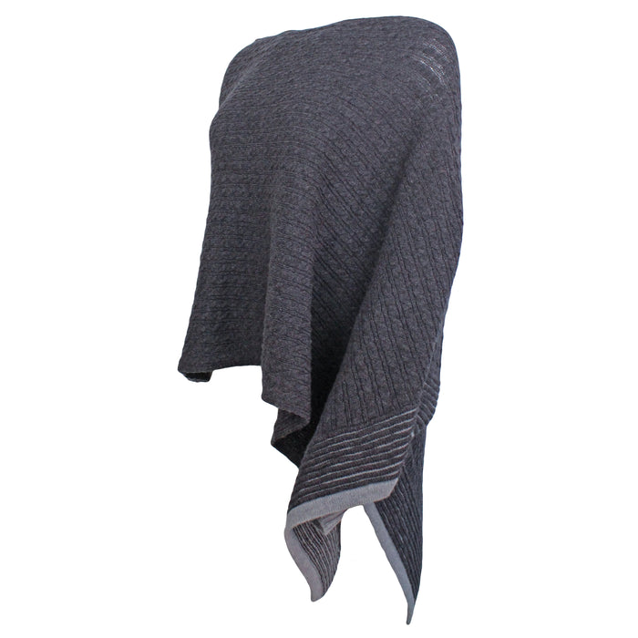 side view of avant garde one arm grey poncho by aine knitwear