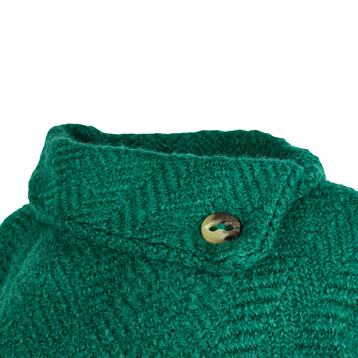 close up button of pine laura poncho by branigan weaver