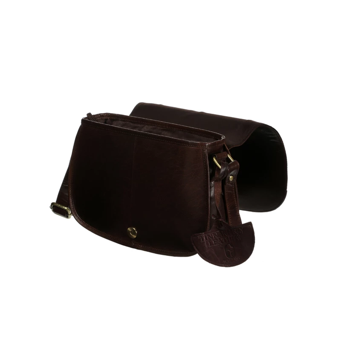 side view of  brown leather saddle bag by tinnakeenly