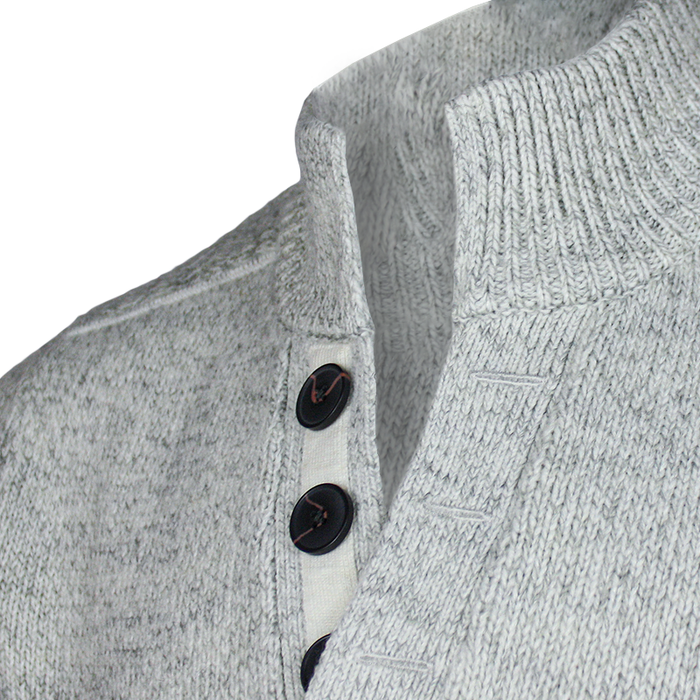 buttons close up of emerald isle winter white galway shawl collar sweater