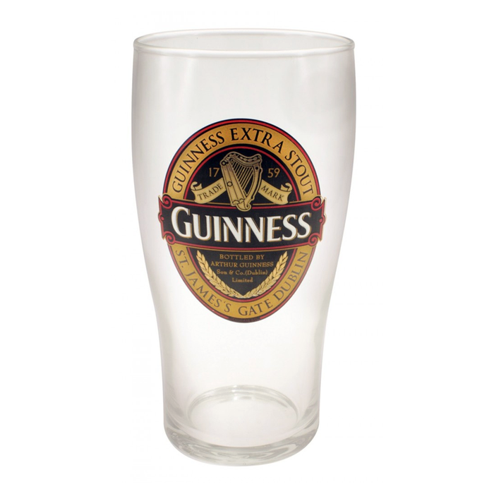 front of classic pint glass by guinness