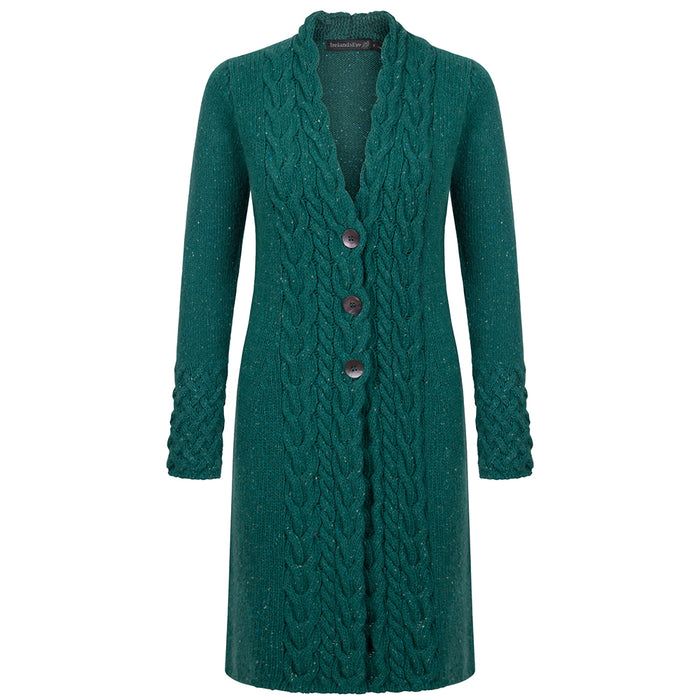 front of green garden horseshoe cable coat by irelands eye knitwear