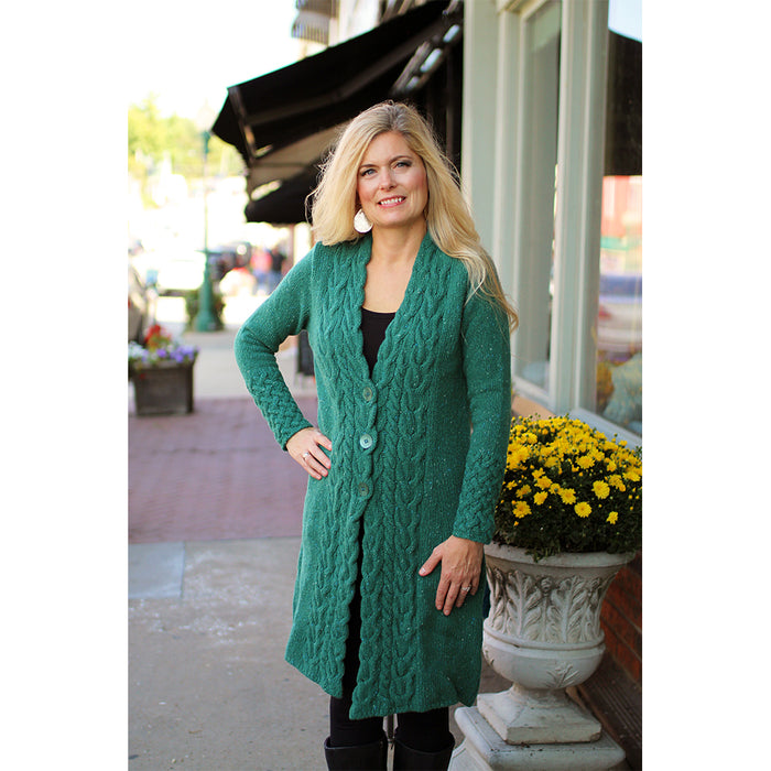 model of green garden horseshoe cable coat by irelands eye knitwear