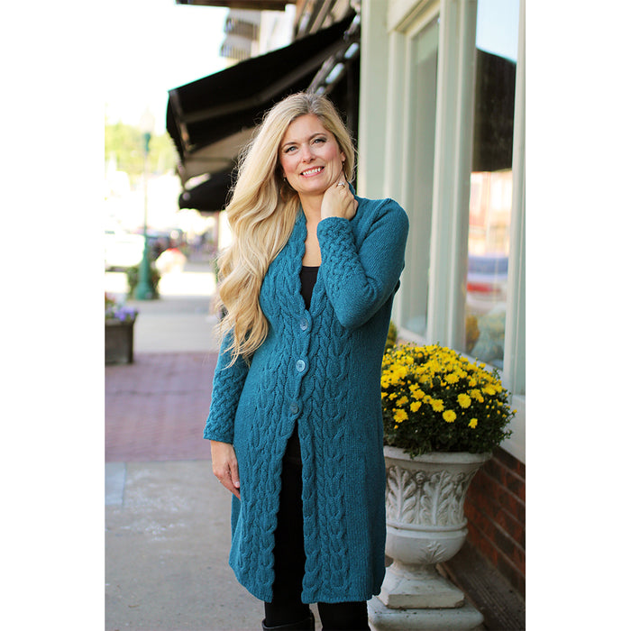 model of teal harbor horseshoe cable coat by irelands eye knitwear
