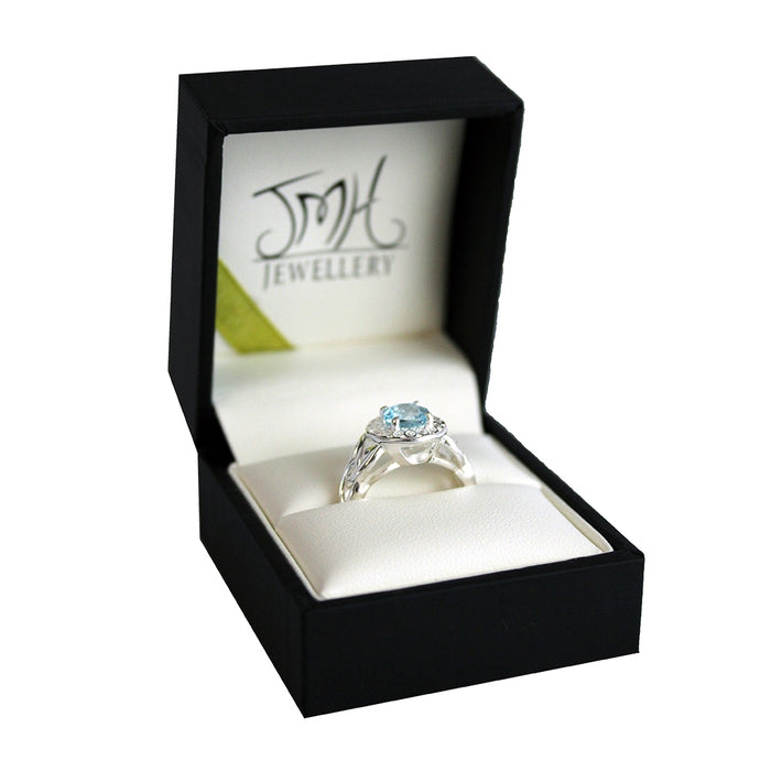 blue topaz and cz halo ring by jmh in gift box