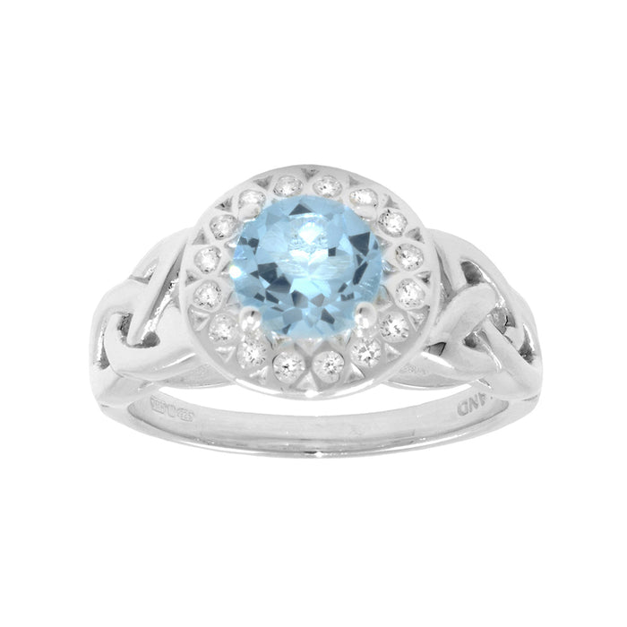 blue topaz and cz halo ring by jmh