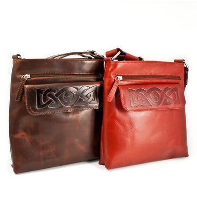 brown and red embossed leather cross body bag by lee river
