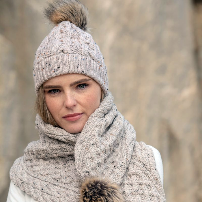model of oatmeal wool cable knit hat by west end knitwear