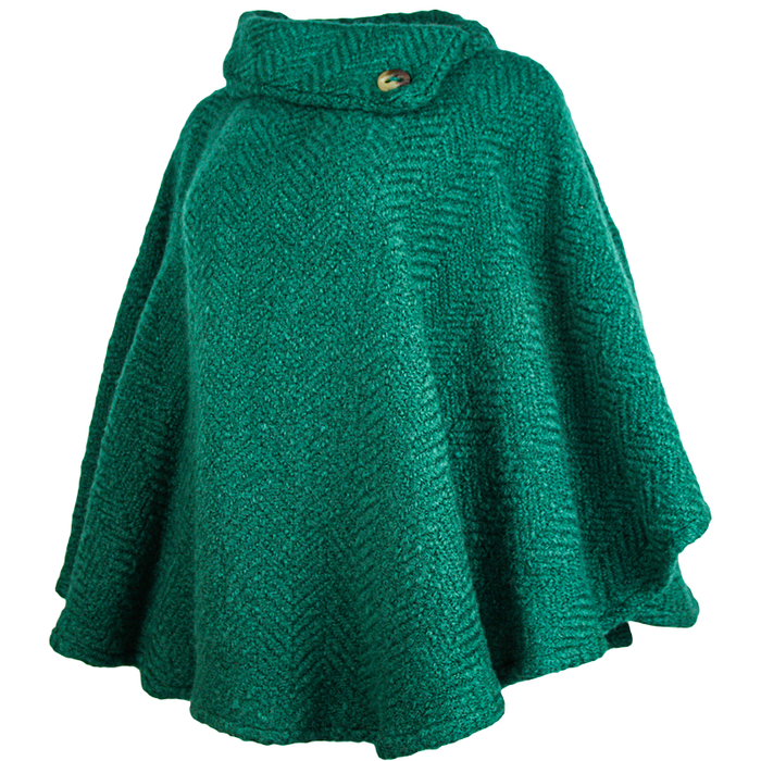 side view of pine laura poncho by branigan weaver