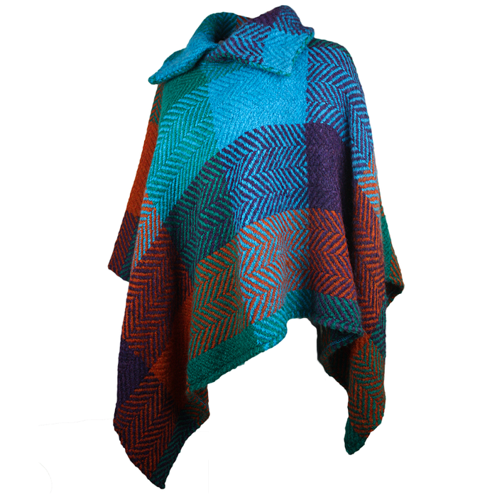 side view of true blue tara pocho shawl by branigan weaver