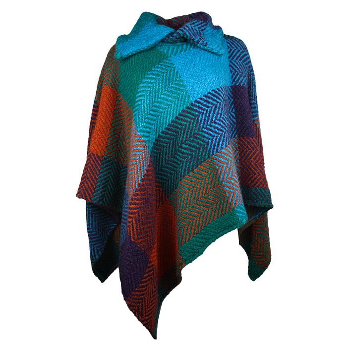 front of true blue tara pocho shawl by branigan weaver