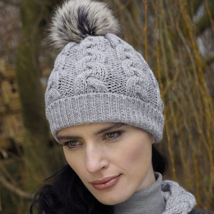 model of soft grey wool cable knit hat by west end knitwear