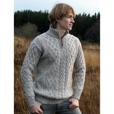 model of oatmeal half zip aran sweater for men by west end knitwear