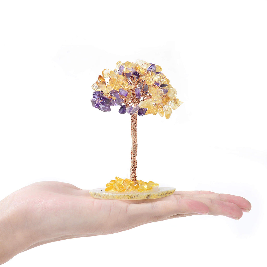 Amethyst and Citrine Gemstone Tree of Life with Agate Base in the palm of a hand