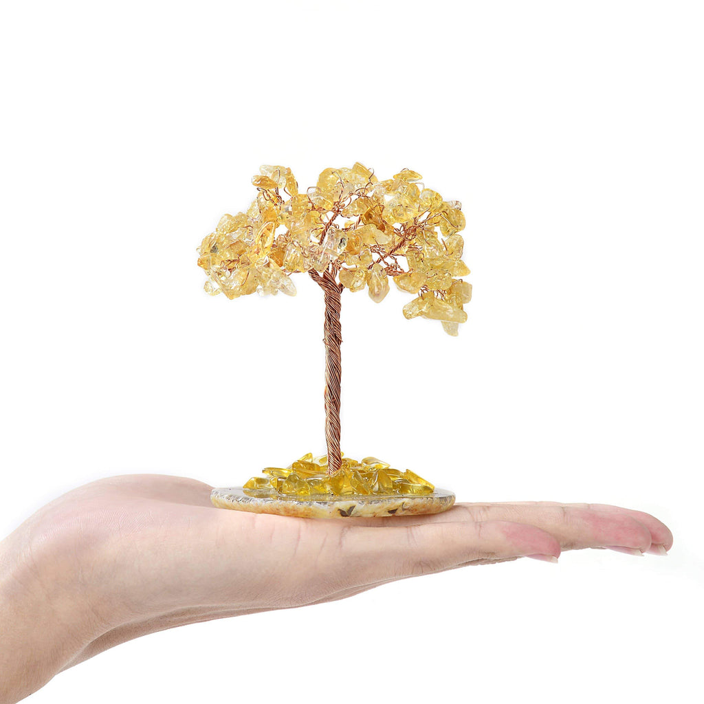 Citrine Natural Gemstone Tree of Life with Agate Base in the pal of a hand
