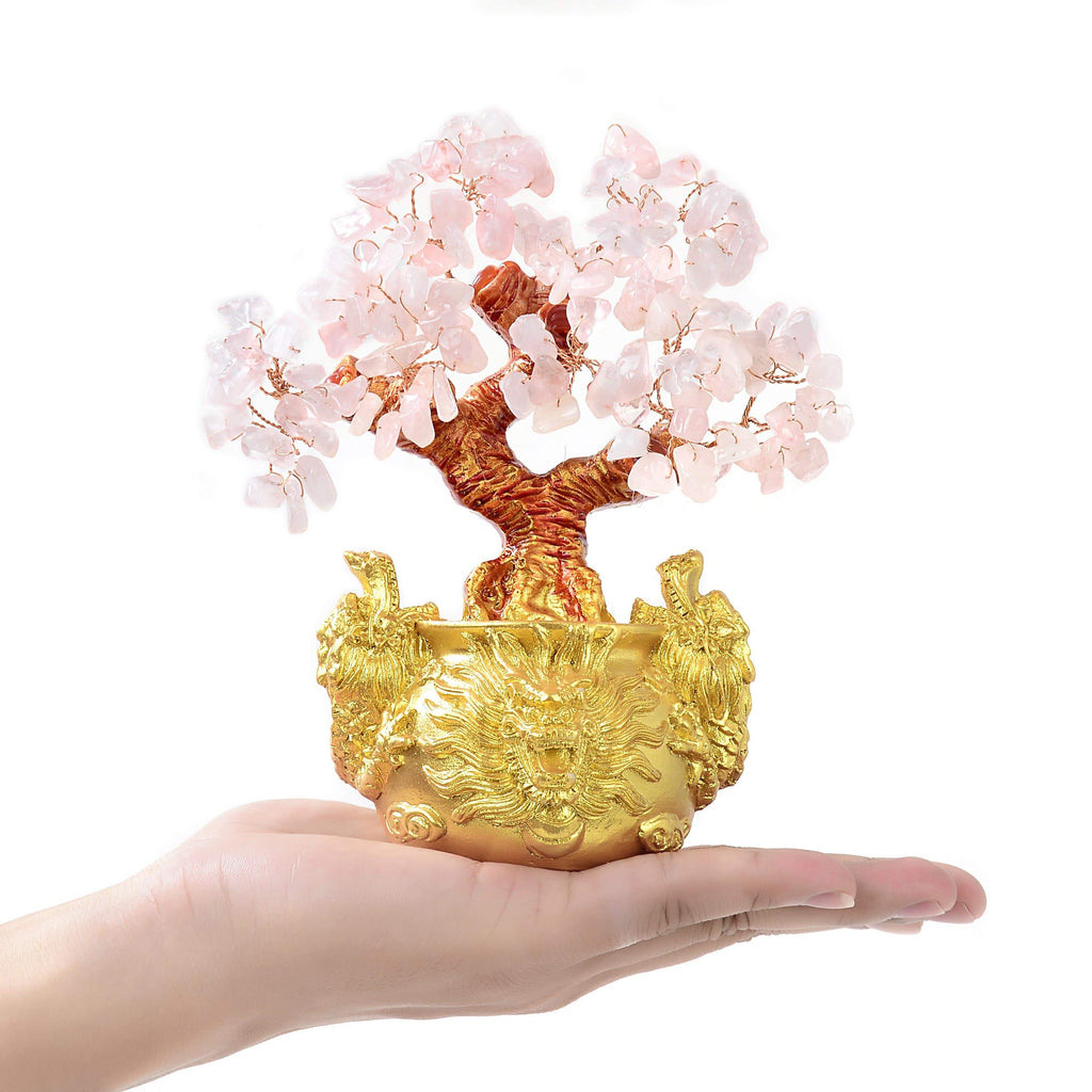 Rose Quartz Natural Gemstone Tree of Life with Dragon Base on the palm of a hand
