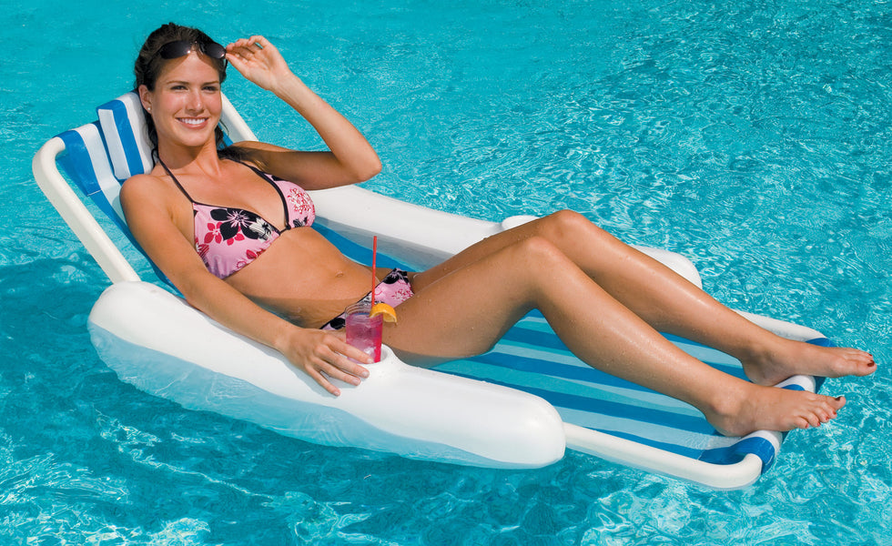 Woman in the SunChaser Sling Style Floating Lounge Chair
