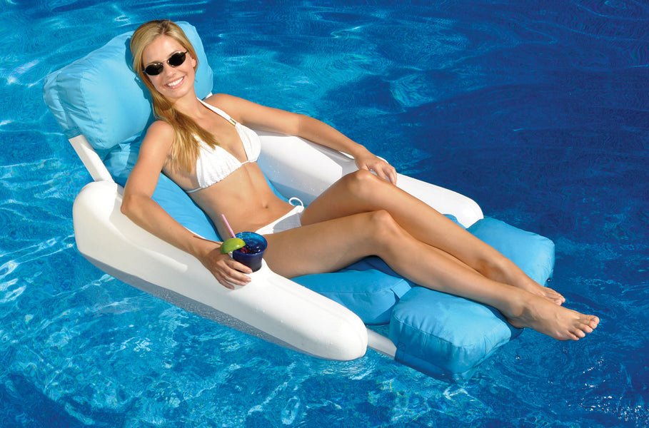 Woman relaxing in the Sunsoft Sunchaser Luxury Lounger