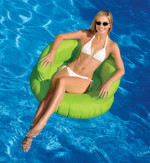 Woman relaxing in her Sunsoft Chair in water