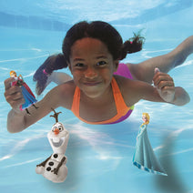 Girl playing with Disney's Frozen Dive Characters