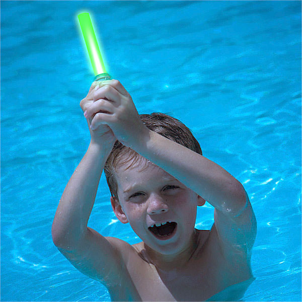 Boy playing with a Star Wars Lightsaber Dive Stick