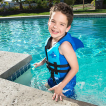 Happy boy wearing the Sea Squirts FINtastic Life Jacket