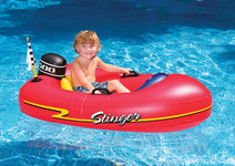 Little boy in his Stinger Speedboat