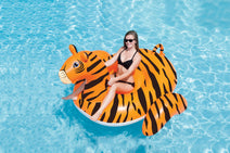 Woman riding a Giant Ride-On Tiger