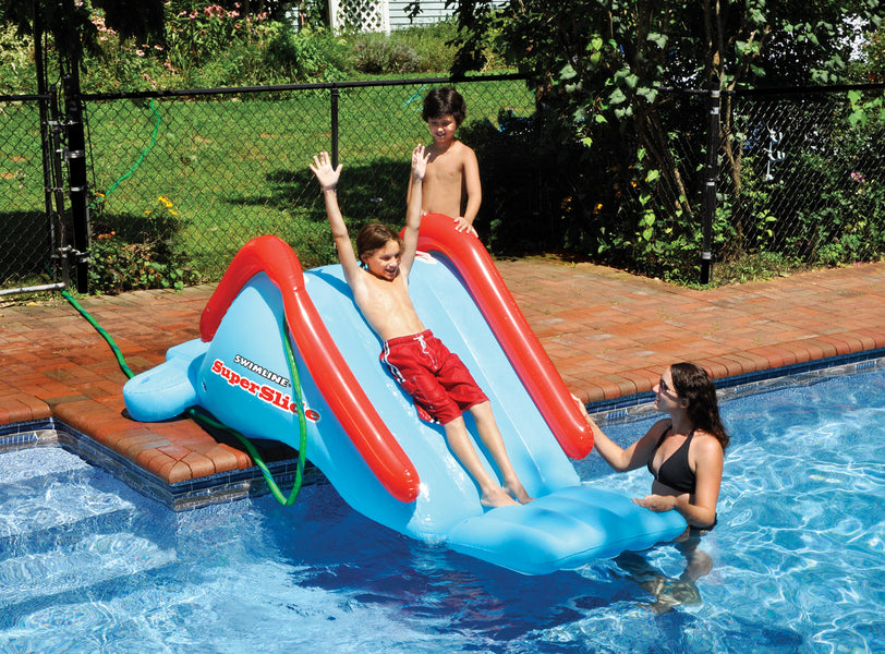Kids playing on the Inflatable Pool Super Slide
