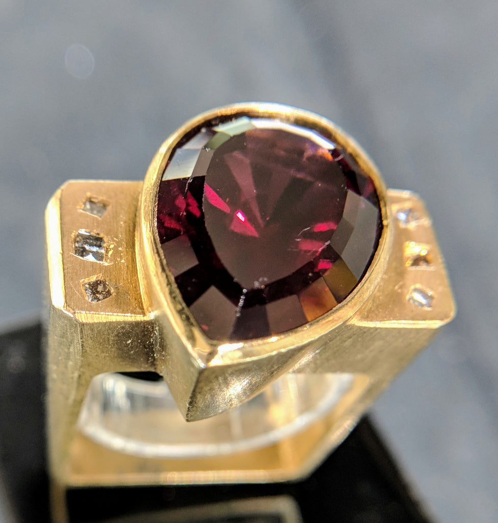 rhodolite garnet ring secrete fine jewelry bethesda dupont circle dc january birthstone diamonds 18k yellow gold sculptural assymetrical