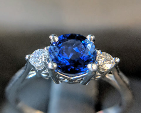 platinum sapphire and diamond three stone engagement ring secrete fine jewelry scroll detail washington dc bethesda md best custom jewelry